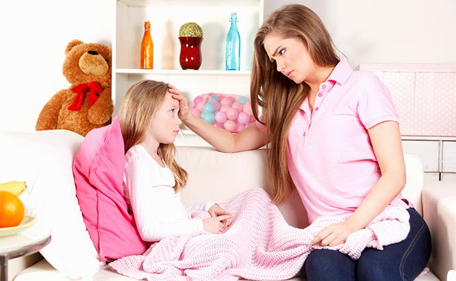 Worried mother with fevered child